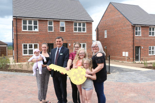 Residents at the new Yorkshire Housing development in Bramley