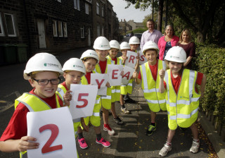 Termrim Construction's Managing Director Graeme Bird with Netherthong Primary School pupils ahead of the Netherthong 10K.